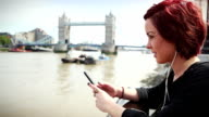 Social networking by the Tower Bridge in London video