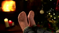 Socks, Feet relaxing in front of a Fire at Christmas video