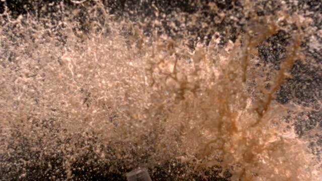 Soda bottle explosion, slow motion video