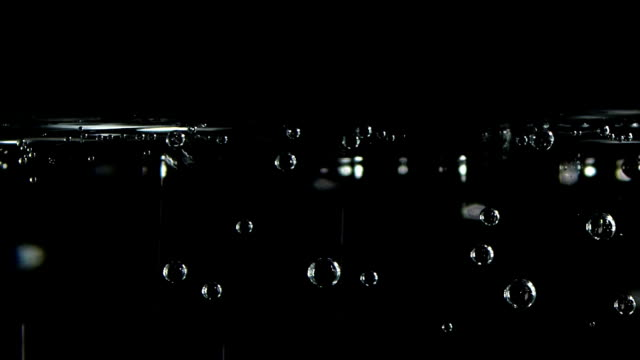 soda water bubbles on a black background video