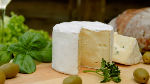 Soft blue cheese with bread, olives and herbs video
