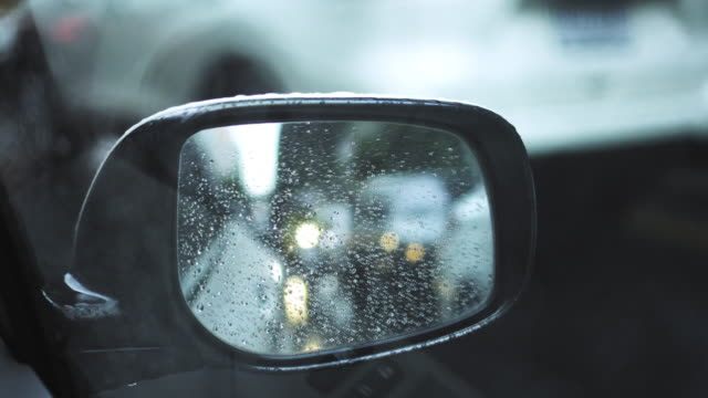 Soft focus of traffic on rainy day. video