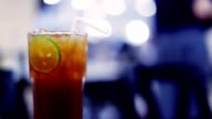 Soft focused Iced tea with lime slice and restaurant background video