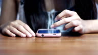 Soft focused young girl browsing smartphone and waiting video