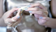 Soft focused young girl's hands crocheting video