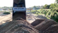 Soil and gravel are dumped by a Truck roadworks video