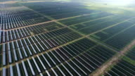 AERIAL: Solar Farm from flying above to flying really far away with the entire solar energy plant in view video