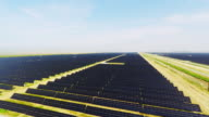 Solar Farm Overhead aerial view of vast alternative energy sun power farm with thousands of solar panels over miles of California valley farmland video