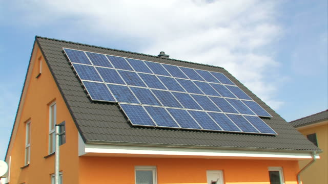 Solar panels on a roof - Photovoltaic cells video