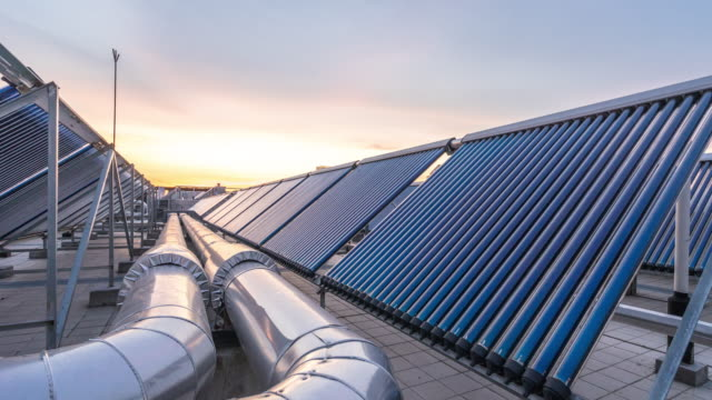 solar water heater and tubes at sunset time lapse video