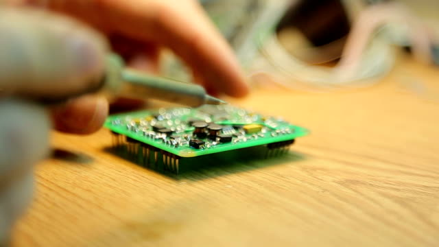 Soldering pads on the device close-up video