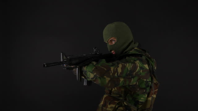 Soldier Aiming Rifle Isolated on Black Background video