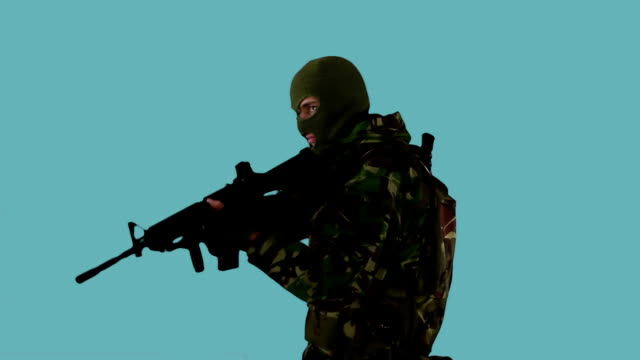 Soldier Aiming Rifle Isolated on Blue Background video