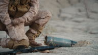 Soldier Defusing a Bomb by Cutting a Wire During Military Operation in Desert Environment video