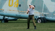 Soldier trains fighting skills. He performs a series of punching and kicking video