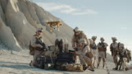 Soldiers are Using Drone for Scouting During Military Operation in the Desert. Slow Motion. video