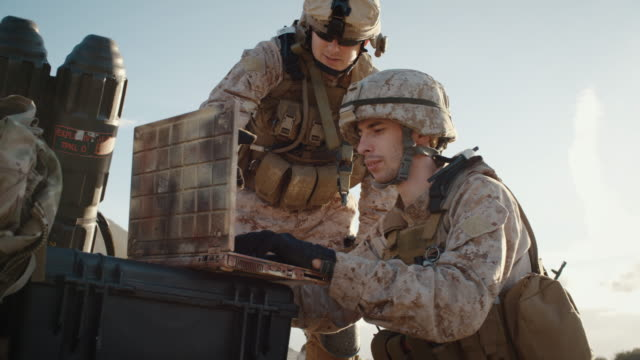Soldiers are Using Laptop Computer for Surveillance During Military Operation in the Desert. Slow Motion. video