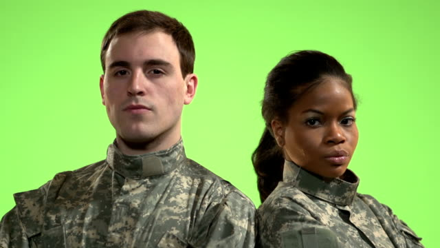 Soldiers in front of green screen standing video