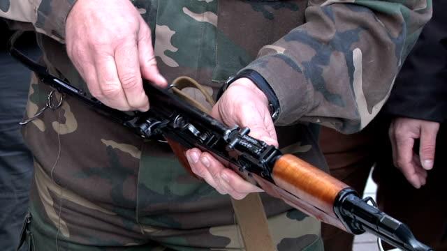 Soldiers parses and cleans Kalashnikov. video