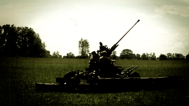 Soldiers prepare howitzer shooting, world war 2 reconstruction. Soviet enginery video