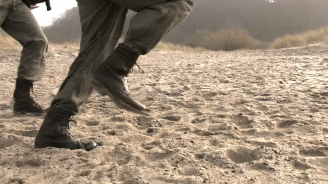 soldiers running on sand steadycam HD video