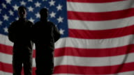 Soldiers Silhouette in front of American flag. video