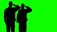 Soldiers Silhouette in front of green screen. video