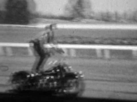 Solo motorcycle stunt--From 1930's film video
