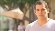 Somber man looks into camera with no expression video