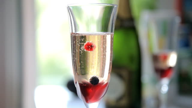 Some berries in glass of champagne video