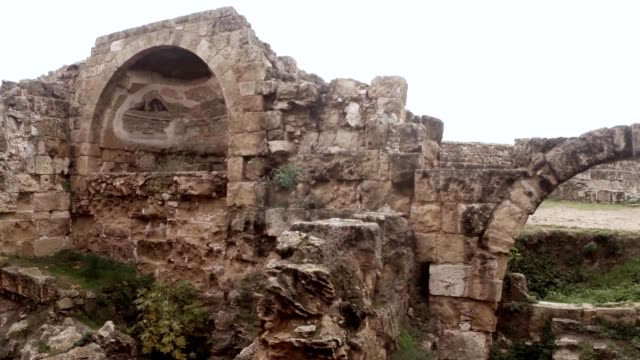 Some remaining mosaics on ruins of antique town Salamis panorama arch east Cyprus Famagusta video