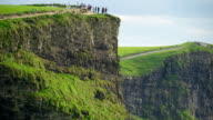 Some tourists on the edge of the Moher Cliffs Ireland video