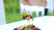 Someone eating healthy salad, closeup video