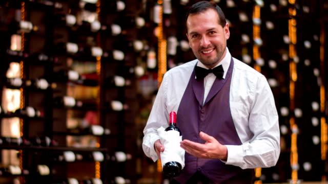 Sommelier holding a bottle of wine video