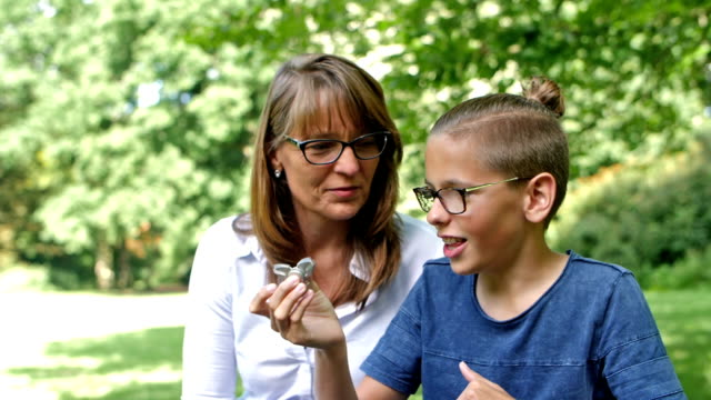 SLOW MOTION: Son showing fidget spinner video