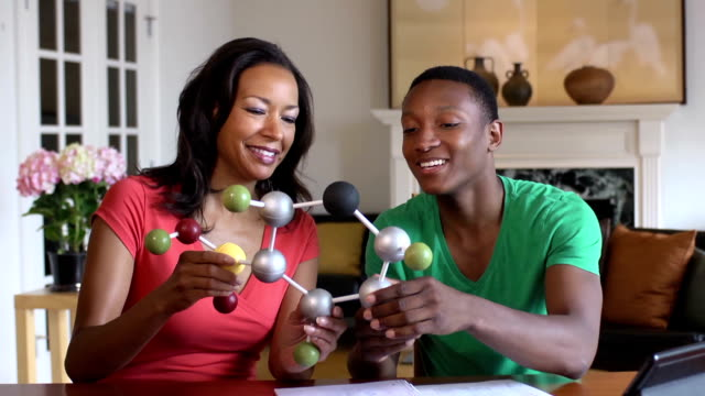 Son Shows Mother his Science Project of a Molecule video