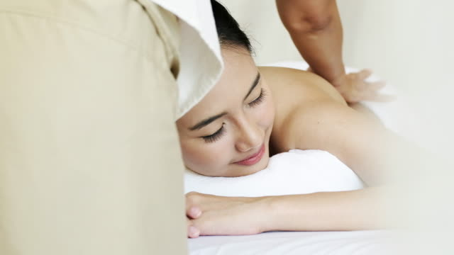 Sophisticated lady relaxing with massage for healthy video