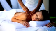 Sophisticated lady relaxing with massage video