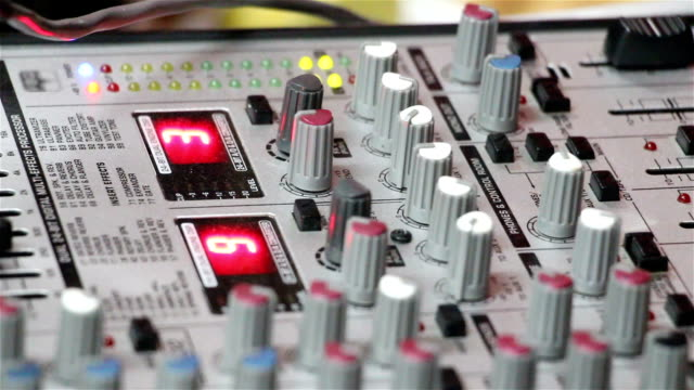 sound mixer pushing buttons close-up. Mixing desks, audio production consoles, soundboards, electronic graphic equalizer, audio sound mastering. video