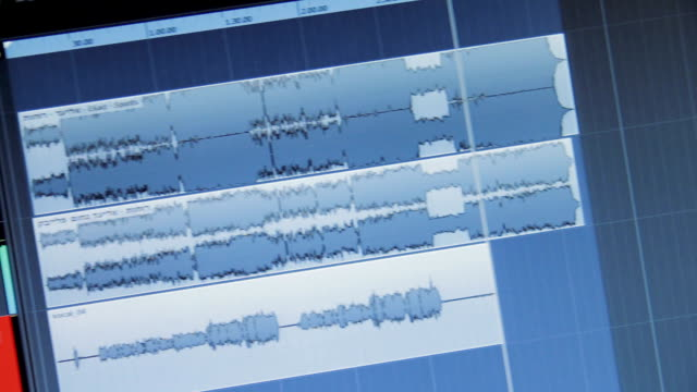 Sound waves on a computer monitor in a recording studio video