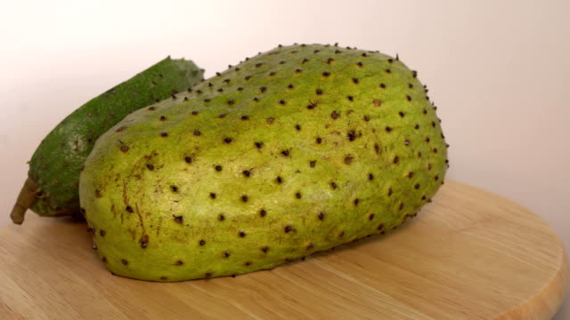 Soursop, Annona muricata L with slice rotate on wooden cutting board video
