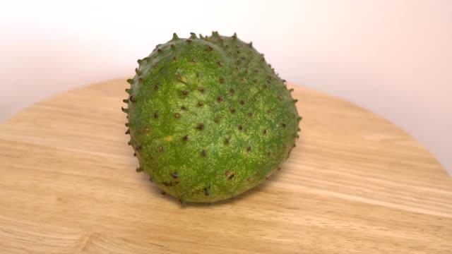Soursop, Custard Apple, Annona muricata L rotate on wooden board video