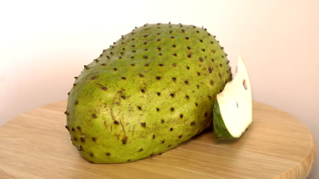 Soursop, Prickly Custard Apple with slice rotate on wooden cutting board video