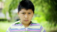 south american child starts smile: outdoor, ten years old, outdoor, face, look video