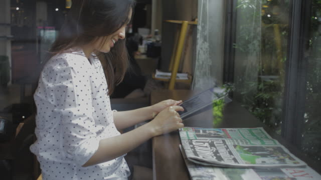 southeast asia woman looking at tablet video