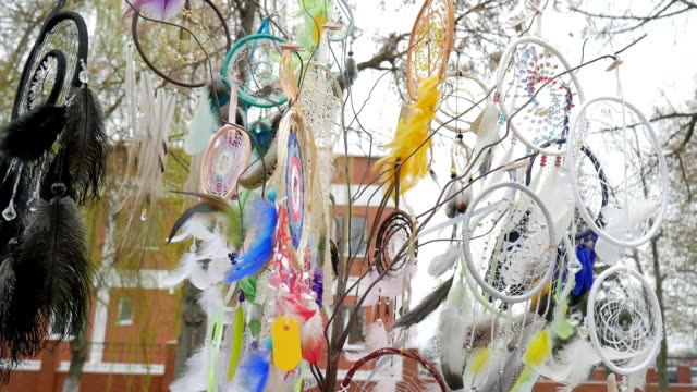 Souvenir dreamcatchers on sale swinging in wind at market stall, Tree with colored catchers, dreamcatcher at outdoors video