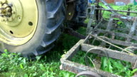 Soviet tractor with old rusty harrows video