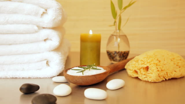 Spa still life of salt scrub with rocks and candle video