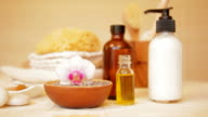 Spa still life with moisturizer, lavender, massage oil and orchid video