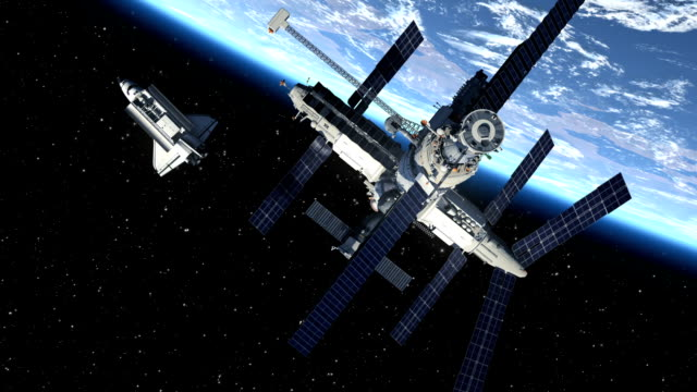 Space Station And Space Shuttle Orbiting Earth video